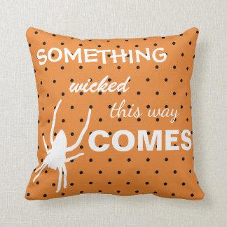 Black polka dots on orange background spider throw pillow