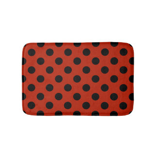 Black polka dots on red bath mat