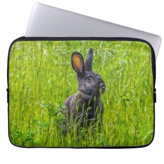 Black rabbit in the grass laptop sleeve