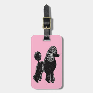 Black Standard Poodle with Pink Luggage Tag