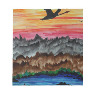 Black swans at sunset notepad