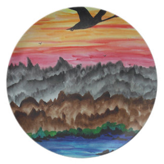 Black swans at sunset plate