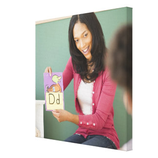 Black teacher showing letter d flash card to canvas print