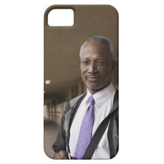 Black teacher standing in school corridor iPhone 5 covers