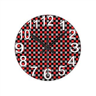 Black white and red chequered round clock