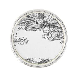 black white floral lapel pin
