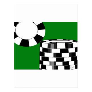 Black white poker chips on green postcard