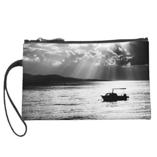 Black & white sun rays through clouds suede wristlet