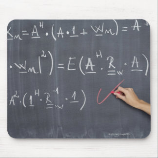 Blackboard with arithmetic s on it close-up mouse pads