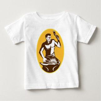blacksmith with hammer striking anvil baby T-Shirt