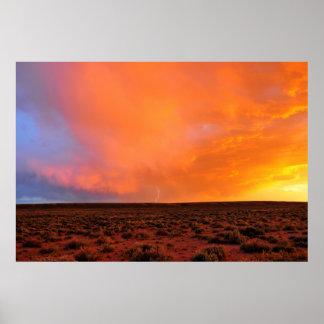 Blazing Sunset with Lightning over Desert Poster