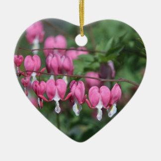 Bleeding heart flowers in heart shaped ornament