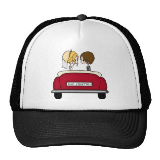Blonde Bride and Brunette Groom in Red Wedding Car Cap