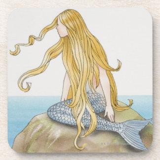 Blonde mermaid sitting on sea rock, side view. coasters
