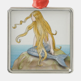 Blonde mermaid sitting on sea rock, side view. Silver-Colored square decoration