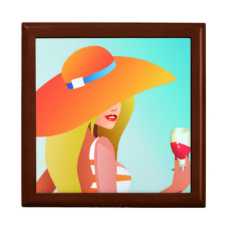 Blonde model with large orange hat holding drink large square gift box