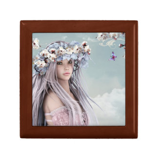 Blonde silver hair model in light pink dress small square gift box