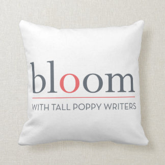 BLOOM red-and-white throw pillow. Cushion