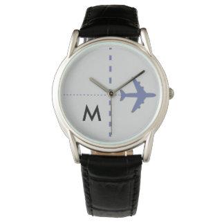 blue aeroplane with initial wrist watch