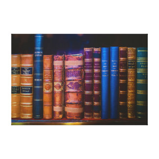 Blue and Gold Cover Book on Brown Wooden Shelf Canvas Print