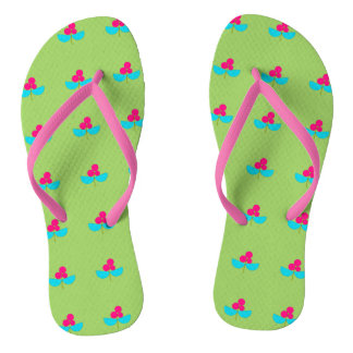 Blue and pink flowers on green flip flops