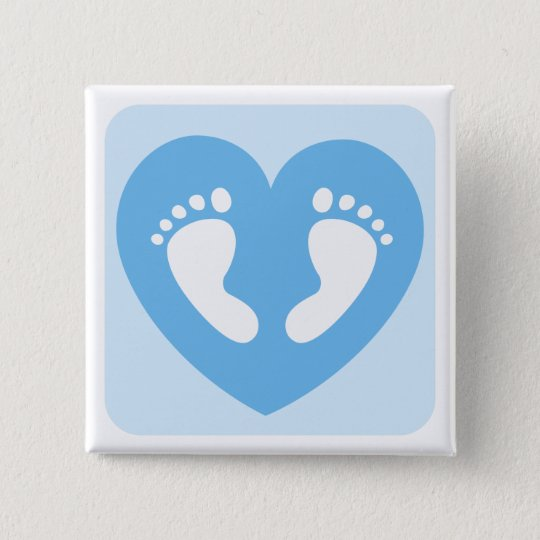 Blue baby boy feet or footprints in heart button