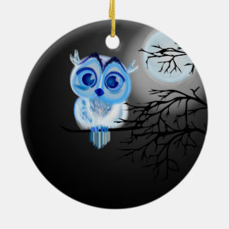 Blue baby owl on moon background. christmas ornament
