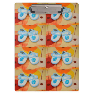 Blue baby shoes clipboard