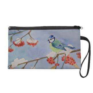Blue bird on a rowan tree branch against blue sky wristlet