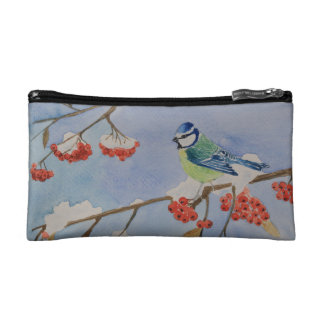 Blue bird on a rowan tree branch makeup bag