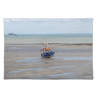 Blue boat at low tide placemat