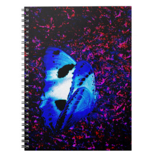 Blue butterfly amongst a colony of bats spiral note book