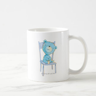 Blue Calico Bear Smiling on Chair Coffee Mug