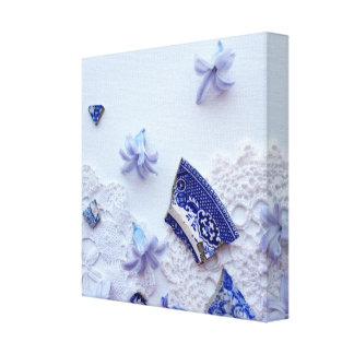 Blue composition - pottery pieces and flowers canvas print