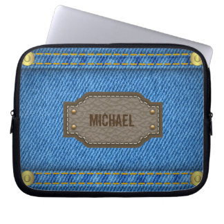 Blue denim jeans with leather name label laptop sleeve
