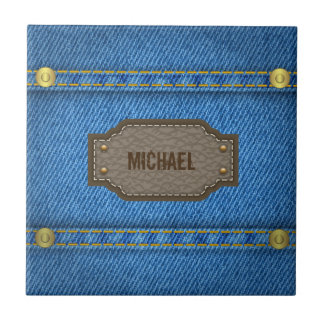 Blue denim jeans with leather name label small square tile