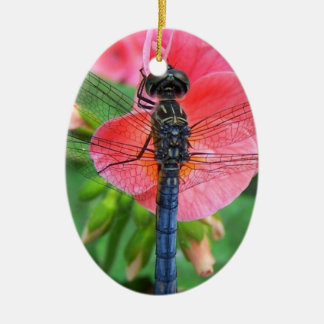 Blue dragonfly on pink flower green background ceramic oval decoration