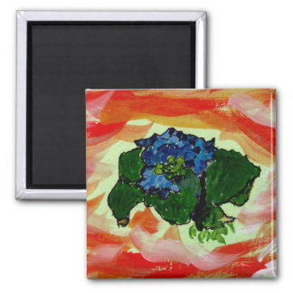 Blue flowers in red sea magnet