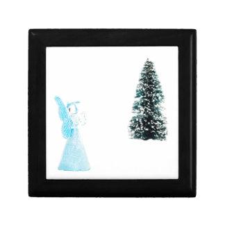 Blue glass angel praying near christmas tree small square gift box
