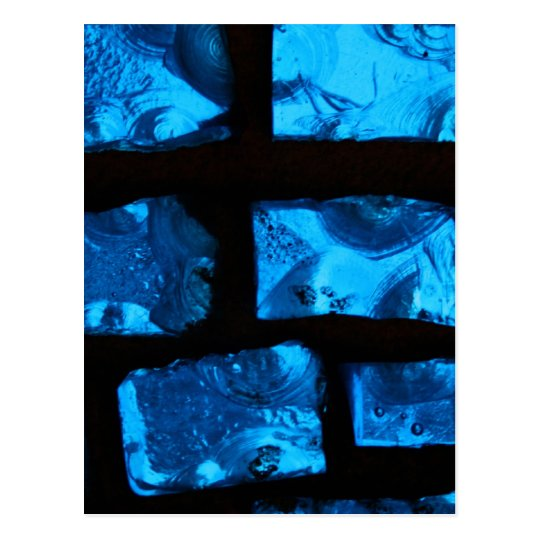 Blue glass chunks with black grout between them postcard