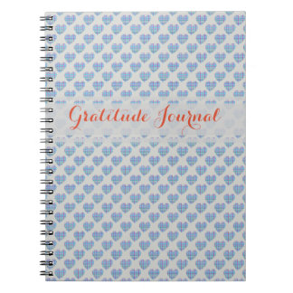 Blue hearts on grey notebooks