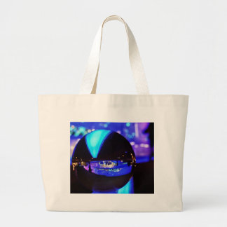 Blue hour through the crystal ball tote bags