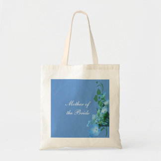 blue hydrangea flowers in blue background tote bag