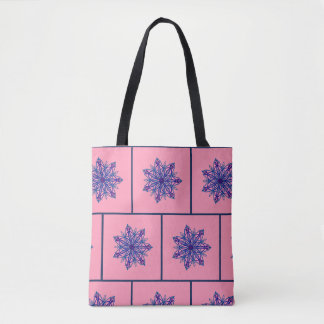 Blue intricate snowflake on pink tote bag