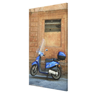 Blue motor scooter by red wall, Siena, Italy Canvas Prints