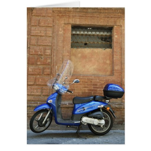 Blue motor scooter by red wall, Siena, Italy Cards