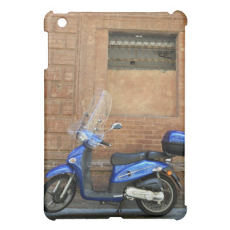 Blue motor scooter by red wall, Siena, Italy iPad Mini Case