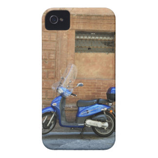 Blue motor scooter by red wall, Siena, Italy iPhone 4 Cases