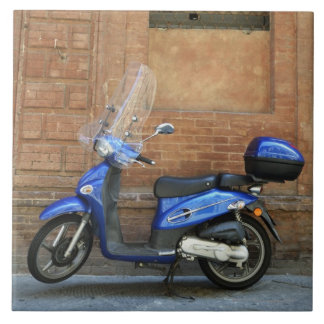 Blue motor scooter by red wall, Siena, Italy Large Square Tile