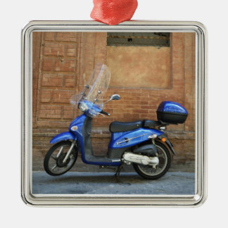 Blue motor scooter by red wall, Siena, Italy Silver-Colored Square Decoration